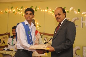 Yasir is receiving sholarship Award from Chairman LGES
